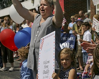 JESSICA M. KANALAS | THE VINDICATOR..As the buses roll in, Maddisen Burke, 5, of Boardman stands by her grandmother ready to welcome home her father, Sgt. Michael Burke of the 292nd Engineer Detachment of the Ohio National Guard.... -30-