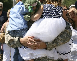JESSICA M. KANALAS | THE VINDICATOR..Sgt. Michael Burke of Boardman holds his two children, Landon, 4, and Maddisen, 5, after returning home from a year-long tour in Kuwait. .. -30-
