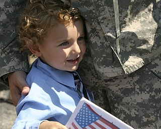 JESSICA M. KANALAS | THE VINDICATOR..Landon Burke, 4, clings to his father, Sgt. Michael Burke from the moment he stepped off the buses to the moment the family left.... -30-