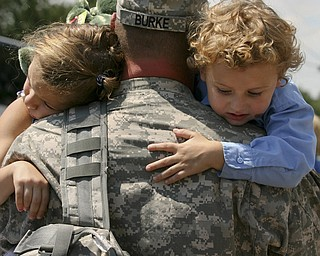 JESSICA M. KANALAS | THE VINDICATOR..Sgt. Michael Burke of Boardman holds his two children, Maddisen, 5, and Landon, 4, after returning home from a year-long tour in Kuwait. .... -30-