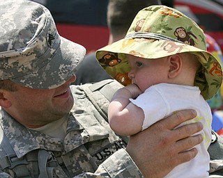JESSICA M. KANALAS | THE VINDICATOR..Sgt. Roy Mitchell holds his four-month-old son, Roy IV, upon his return to his family. ... -30-