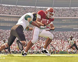 """In this screen grab image provided by EA Sports, an Oregon Ducks defender brings down an Alabama player in the video game """"NCAA Football 12."""" (AP Photo/EA Sports)"""