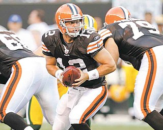 Cleveland Browns quarterback Colt McCoy turns to hand off the ball against the Green Bay Packers in the first quarter of their preseason NFL football game on Saturday, Aug. 13, 2011, in Cleveland.  (AP Photo/Tony Dejak)