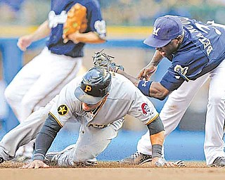 Pittsburgh Pirates' Xavier Paul, left, steals second base in the seventh inning of a baseball game ahead of the tag by the Milwaukee Brewers' Yuniesky Betancourt, right, Sunday, Aug 14, 2011, in Milwaukee.  (AP Photo/Jeffrey Phelps)