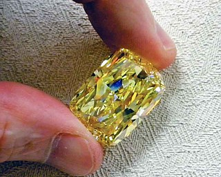 """This undated photo provided by the U.S. Marshals Service shows a large yellow diamond.  The large yellow diamond, known as the """"Golden Eye,"""" was seized in a federal drug and money laundering investigation in northeast Ohio and is going on the auction block with the minimum bid to start at $900,000. The 43.51 carat diamond belonged to an Ohio businessman convicted of money laundering and conspiracy. A refundable deposit of $180,000 is required to be able to view the diamond in Cleveland the week of Aug. 29-Sept. 2 and bid on it during the auction that begins at 8 a.m. on Sept. 6 and continues until 3 p.m. Sept. 8. (AP Photo/U.S. Marshals Service)"""