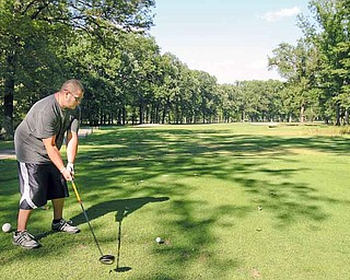 JESSICA M. KANALAS | THE VINDICATOR..CJ Rach, 25, of Youngstown tees off at the 18th hole at the Mill Creek Golf Course in Boardman. Construction is about to start on the hole, moving it and allowing for an expanded driving range to be built. . .-30-