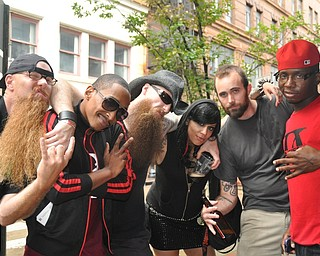 Unlikely friends: Members of Brooklyn's Demolitia and Youngstown's Da Kreek befriend one another during VexFest 8 in downtown Youngstown on Sunday, August 14, 2011.