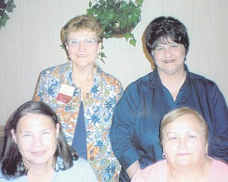 ABWA officers installed: New officers were installed at the July 12 meeting of the Mill Creek Chapter of American Business Women's Association. Outgoing President Judy Codespote, who was honored at the August meeting for her work, handled the installations. The new officers are, clockwise from bottom left: Joyce Billock, treasurer; Jackie Fischio, secretary; Bonnie Pannunzio, vice president; and Shirley Pappagallo, president.