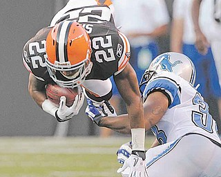 Cleveland Browns' Buster Skrine (22) is upended by Detroit Lions cornerback Paul Pratt on a first-quarter kick return in a preseason NFL football game Friday, Aug. 19, 2011, in Cleveland. (AP Photo/Amy Sancetta)