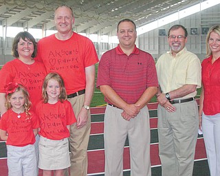 Front from left, Alyson Smith, this year's Heart Child, and her sister, Emilee, stand in front of their parents, Kevin and Kathy Keaggy Smith. The Smiths will participate in the 2011 Heart Walk Sept. 17 at Youngstown State University. This year's walk chairman is Wes Prout, center; and emcee is Thomas John Meister of Clear Channel Radio, Youngstown. At right is Theresa Weakley, news anchor for WKBN 27 First News, one of this year's Walk media sponsors.