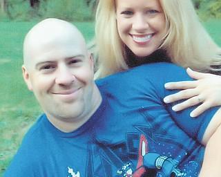Justin P. Democko and Kristen M. Mikus