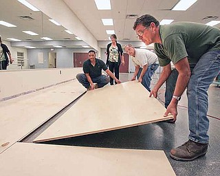 Chaney High School in Youngstown opens as a Science, Technology, Engineering and Math and visual- and performing-arts school for sixth- through 12th-graders this year. Workers last week laid a dance floor in what used to be the school's weight room.