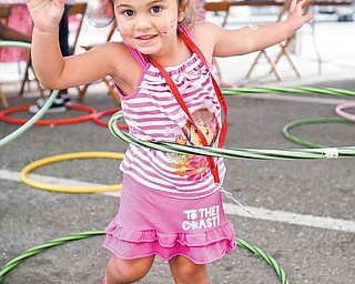 JESSICA M. KANALAS | THE VINDICATOR..Three-year-old Dannilyn DeJesus of Struthers hoola-hoops during the first Spanish Heritage Festival in Downtown, Youngstown... -30-