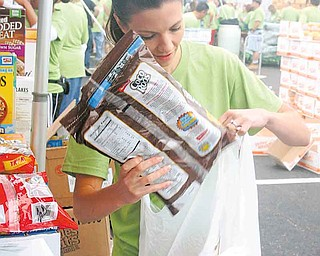 New Life Church, 2250 E. Western Reserve Road, sponsored its second annual Goodness Invasion on Saturday, a free-food distribution, at the Covelli Centre, 229 E. Front St. The event last year drew about 2,000 people, organizers said.  Joanne Taylor of New Middletown helped to pack cereal for distribution.
