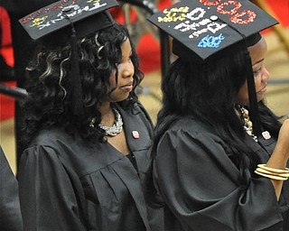 Graduates from the 2011 YSU ceremony held at the Beeghly Center showcase their unique hats...Photo By:  Lindsay Y McCall | The Vindicator