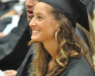 Nicole Sabo laughs at a joke YSU President Cynthia E. Anderson told to the graduates at the the 2011 Summer commencement.  Nicole graduated with a major in Food and Nutrition from the College of Health and Human Services....Photo By:  Lindsay Y McCall | The Vindicator
