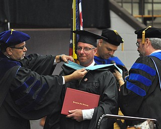 Jason R. Mays earns his Masters of Educational Administration degree at the 2011 YSU summer commencement...Photo By:  Lindsay Y McCall | The Vindicator