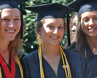 Kayla Renee Witmer posing with her friends after graduating from the Bitonte College of Health and Human Services at YSU..Photo By:  Lindsay Y McCall | The Vindicator
