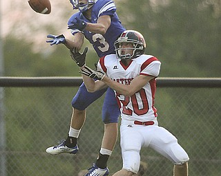 ROBERT  K.  YOSAY  | THE VINDICATOR --..JUMP and TD --  #3 Western Reserves  Tim Cooper  hauls in a pass for a touchdown  as #20 Wyatt Ford  tries to defend - Second Quarter action - Western Reserve Blue Devils  vs Mathews Mustangs at  Western Reserve Stadium Thursday night .--30-..(AP Photo/The Vindicator, Robert K. Yosay)