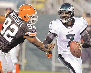 Philadelphia Eagles quarterback Michael Vick (7) scrambles away from Cleveland Browns defensive end Jayme Mitchell (92) during the first half of a preseason NFL football game on Thursday, Aug. 25, 2011, in Philadelphia. (AP Photo/Matt Rourke)