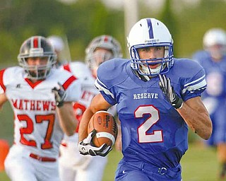 Western Reserve's Donnie Bolton (2) sprints past Mathews Ryan Mazey (27) on an 85-yard touchdown run in the fi rst quarter of Thursday's season opener at Western Reserve Stadium. Bolton scored three times for the Blue Devils, who dominated the Mustangs, 52-19.