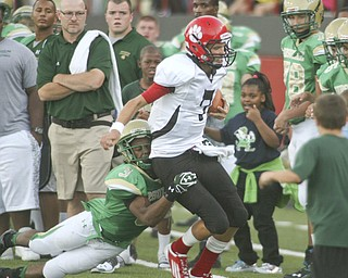 ROBERT K. YOSAY | THE VINDICATOR..David   Sills  Red Lions QB is tackeld out of bounds by Ursulines #3 Kevin Cylar -Youngstown Ursuline vs Red Lion  Christian Academy  at Stambaugh Stadium  Friday night. .----..... -30-