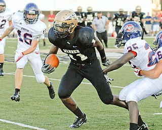 Warren Harding's #11MikQuan Dorsey runs downfield after making a catch over Fitch defenders #25 Justin Fooks #6 Lucas Haupt and #16 Kevin Betts.