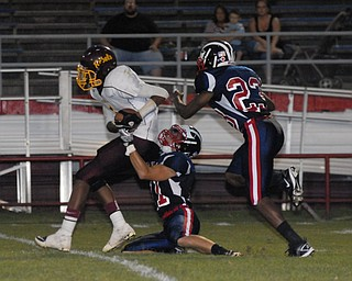John Adams #1Tevin Griffin is tackled after making an interception by Niles players #11L.J. Cox and #23 Darius Harris.