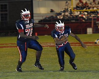 Niles Running back #25 Tommy Duffy runs upfield after getting a block from meam mate #70 T.J. Brown.