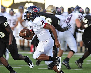Fitch quarterback #2 Demitrious Davis runs around the corner on a quarterback draw.