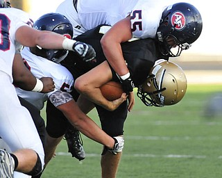 Fitch defensive linemen #55 Mike Stiffler sacks Warren Harding quarterback #12 Josh Martz.
