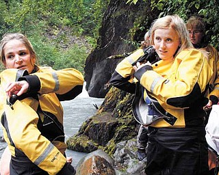 In this photo taken Aug. 18, 2011, ,Julie Robinson of Ligonier, Pa., left, and Jennifer Hankins of San Diego, put on wet suits before a white water rafting trip on Crow Creek, near Girdwood, Alaska during an Alaska Adventure excursion. The event was organized by Tragedy Assistance Program for Survivors for a group of about 75 widows of military veterans to share memories of loved ones while while hiking rugged trails and rafting the rapids. (AP Photo/Mark Thiessen)