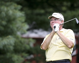 JESSICA M. KANALAS | THE VINDICATOR..Dan Kinney watches has ball after teeing off during day two of the Greatest Golfer Tournament at Youngstown Country Club... -30-