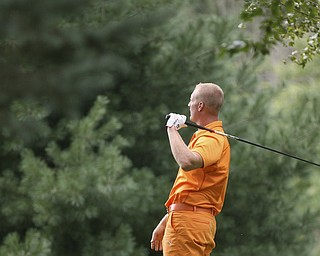 JESSICA M. KANALAS | THE VINDICATOR..Brian Stauffer watches his ball after teeing off during day two of the Greatest Golfer Tournament at Youngstown Country Club... -30-