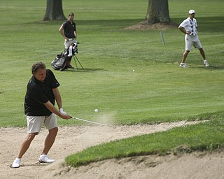 JESSICA M. KANALAS | THE VINDICATOR..Jim Slivanya chips his ball out of a sand pit during day two of the Greatest Golfer Tournament at Youngstown Country Club... -30-