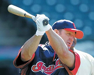 Cleveland Indians' Jim Thome  warms up during batting practice before a baseball game against the Kansas City Royals Friday, Aug. 26, 2011, in Cleveland. Nine years after leaving and losing some fans and credibility, Thome returns to the Indians, his team for 12 seasons and one that needs his big swing to help them get to the postseason. (AP Photo/Mark Duncan)