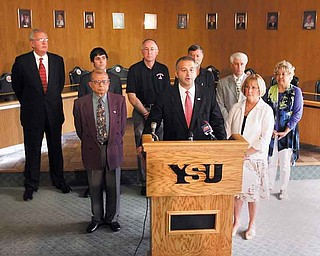 Scott Schulick, a YSU trustee, addresses the press Friday regarding negotiations with the faculty union. Trustees said they'll listen to what the union has to say but won't spend more than what's contained in the last offer.