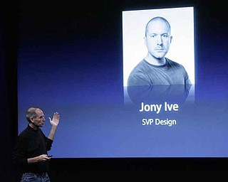 FILE - In this Oct. 14, 2008 file photo, Apple CEO Steve Jobs talks about Jonathan Ive, Apple senior vice president of Industrial Design, at a meeting in Cupertino, Calif. Jobs may be the company's most recognizable personality, but much of its cachet comes from its clean, friendly-looking designs _ the product of its head designer, Jonathan Ive. (AP Photo/Paul Sakuma, File)