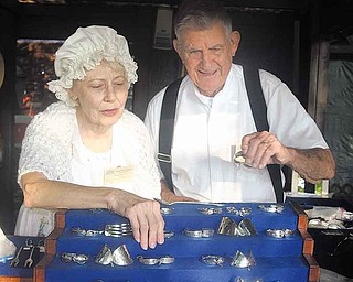 SHAKER WOODS - Joan and Bob Schriever from Cincinnati display thier custom made silver at the Shaker Woods fair Saturday. - Special to The Vindicator/Nick Mays