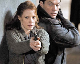 Jessica Chastain (left) and Sam Worthington (right) star in John Madden's espionage thriller THE DEBT, a Focus Features release.