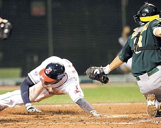 Ezequiel Carrera, left, of the Indians scores ahead of the tag from Athletics catcher Kurt Suzuki in the sixth inning of Monday's game. Carrera scored on a double by Kosuke Fukudome.