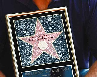"""Actor Ed O'Neill poses for photographers after receiving a star of the Hollywood Walk of Fame in Los Angeles, Tuesday, Aug. 30, 2011.  O'Neill currently stars on the television show """"Modern Family"""". (AP Photo/Matt Sayles)"""