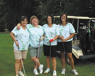 Committee members of the Scramble Fore Education, sponsored by St. Patrick School in Hubbard, were, from left, Renie DiTommasio, Cindy Lacko, Mellony Leonard and Jen DiPizzo. The event benefits the school, and this year it helped fund the new computer lab, which was installed over the summer. Ed Madeline and his committee coordinated the outing, and lunch and dinner were provided by Tom Watkins Catering. This year's prize, a one-year lease on a new car for a hole-in-one, was donated by Stadium GM.