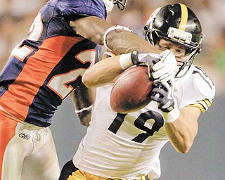 Denver Broncos cornerback Alphonso Smith (22) breaks up a pass intended for Pittsburgh Steelers wide receiver Tyler Grisham (19) during the second half of a preseason NFL football game Sunday, Aug. 29, 2010, in Denver. (AP Photo/Jack Dempsey)