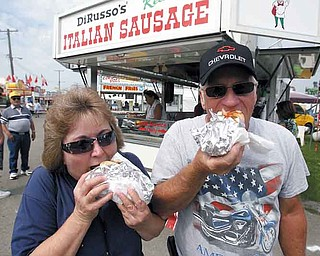 Larry and Debbie Jones of Newton Falls enjoy the original DiRusso  hot sausage sandwich.