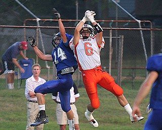 FOOTBALL - (6) Kenny Pozega battles Jake Pishotti for the ball during thier game Thursday night in Cortland. - Special to The Vindicator/Nick Mays