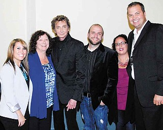 Barry Manilow, third from left, met with Covelli Centre officials after his concert at the Youngstown venue. Pictured are, from left, Kelsey Rupert, director of sales and marketing; Susan Jacobson, director of finance; Manilow; Ken Bigley, assistant director; Tracy Biery, box-office manager; and Eric Ryan, executive director.