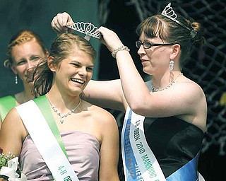 Melissa Moliterno, 17, left, the 2011 Junior Fair queen, gets her tiara from last year's queen DeLorean Jones of Austintown. Melissa, of Canfield, received the honor Thursday at the Canfield Fair's annual Youth Day Royal Court ceremony.