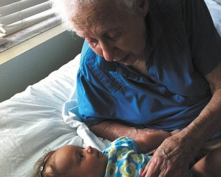 Mattie Tibolla, 3 months old, loves listening to the stories her 94-year-old great-grandma (Baba) Veronica Tabak tells her! Both are of Austintown. Photo submitted by Amy Tibolla, Mattie's mom.