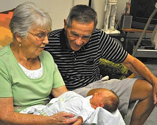 Great-grandparents Don and Bev Kuhns of Greenford meet their first great-granddaughter, Naomi Lane of Wahalding, Ohio, for the very first time!